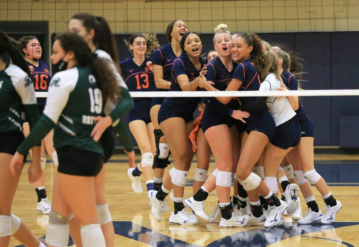 The Brandeis volleyball team celebrate after the final point against Reagan at Paul Taylor Fieldhouse on Tuesday, Oct. 12, 2021. The Broncos prevailed, 3-1 in sets, to take the night's win.