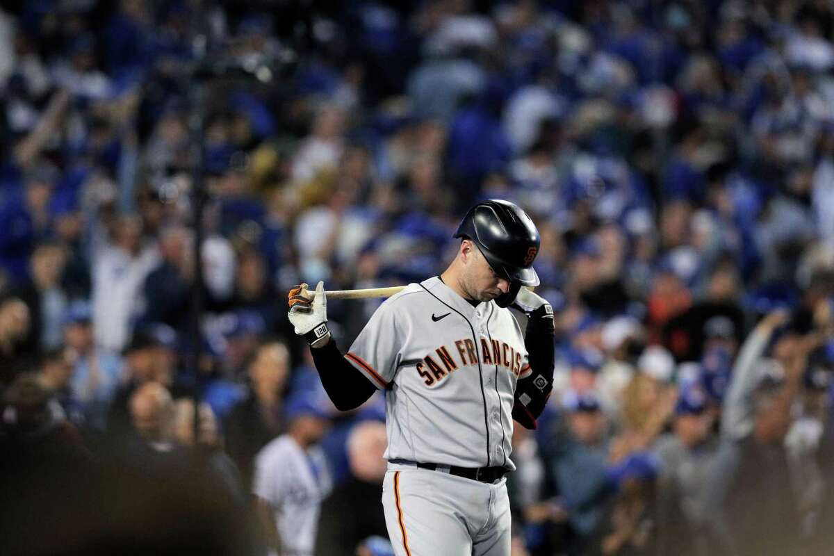 San Francisco Giants Buster Posey (28) warms up in the on-deck circle as the San Francisco Giants played the Los Angeles Dodgers in Game 4 of the National League Division Series at Dodger Stadium in Los Angeles, Calif., on Tuesday, Oct. 12, 2021.