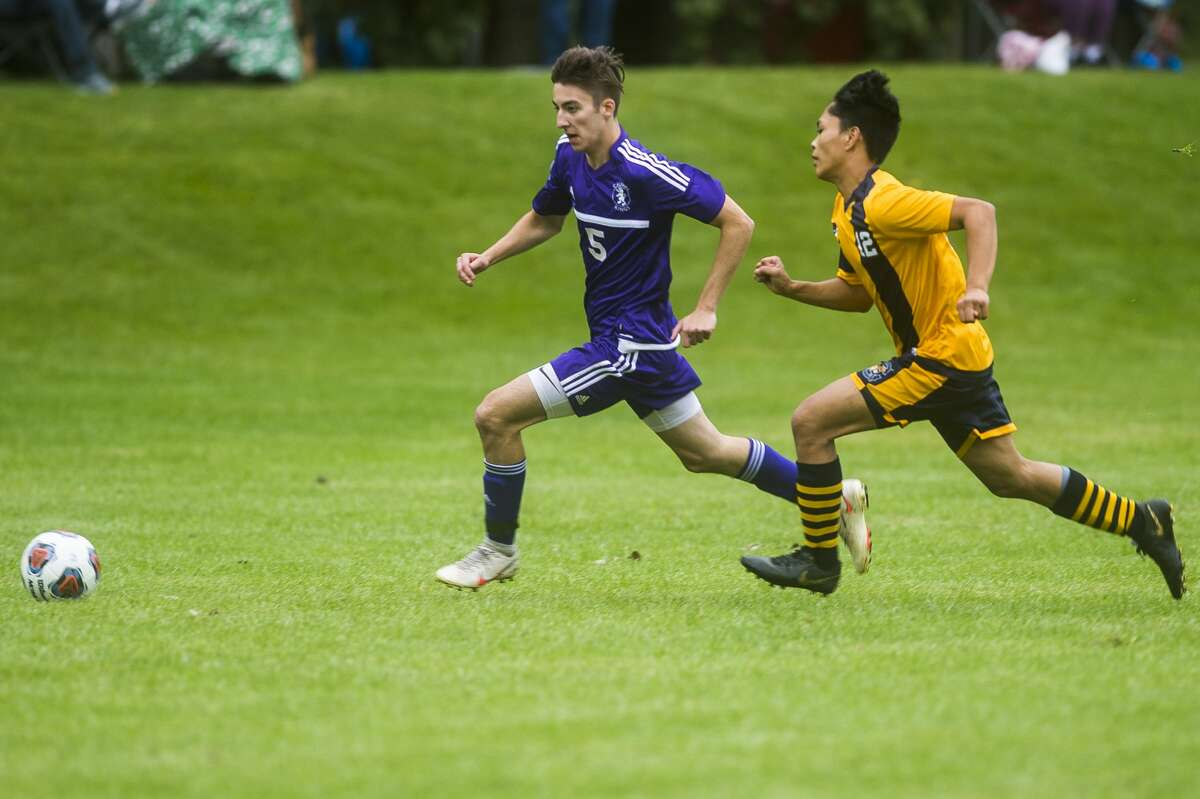Calvary Baptist's Eric Grabill chases down the ball during a Sept. 8, 2020 game against Bethany Christian.