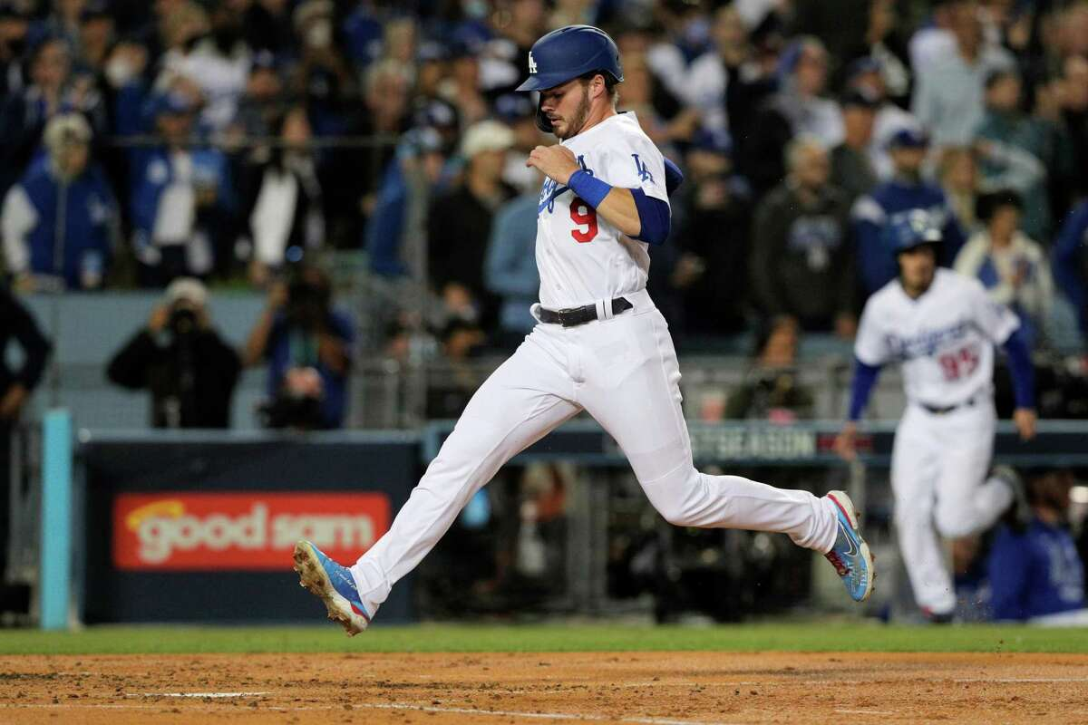 Los Angeles Dodgers Gavin Lux (9) scores on a sacrifice fly hit by Chris Taylor (3) during the bottom of the second inning as the San Francisco Giants played the Los Angeles Dodgers in Game 4 of the National League Division Series at Dodger Stadium in Los Angeles, Calif. on Tuesday, Oct. 12, 2021.