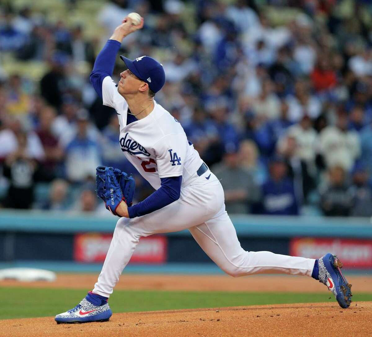 Los Angeles Dodgers starting pitcher Walker Buehler (21) throws during the first inning as the San Francisco Giants played the Los Angeles Dodgers in Game 4 of the National League Division Series at Dodger Stadium in Los Angeles, Calif. on Tuesday, Oct. 12, 2021.