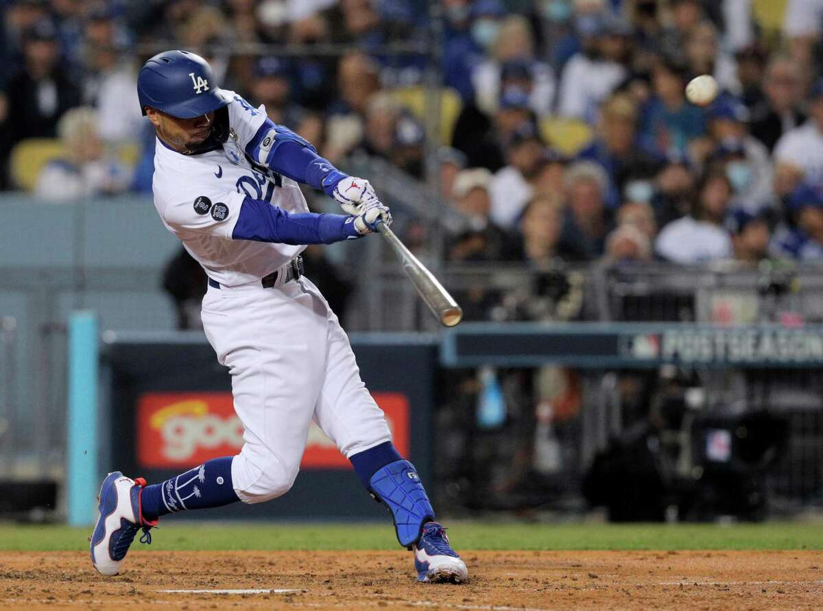 Los Angeles Dodgers Mookie Betts (50) hits a 2-run homer during the bottom of the fourth inning as the San Francisco Giants played the Los Angeles Dodgers in Game 4 of the National League Division Series at Dodger Stadium in Los Angeles, Calif., on Tuesday, Oct. 12, 2021.