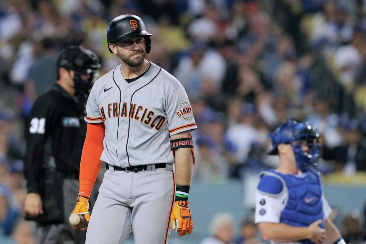 San Francisco Giants Evan Longoria (10) reacts after striking out swinging during the top of the second inning as the San Francisco Giants played the Los Angeles Dodgers in Game 4 of the National League Division Series at Dodger Stadium in Los Angeles, Calif. on Tuesday, Oct. 12, 2021.