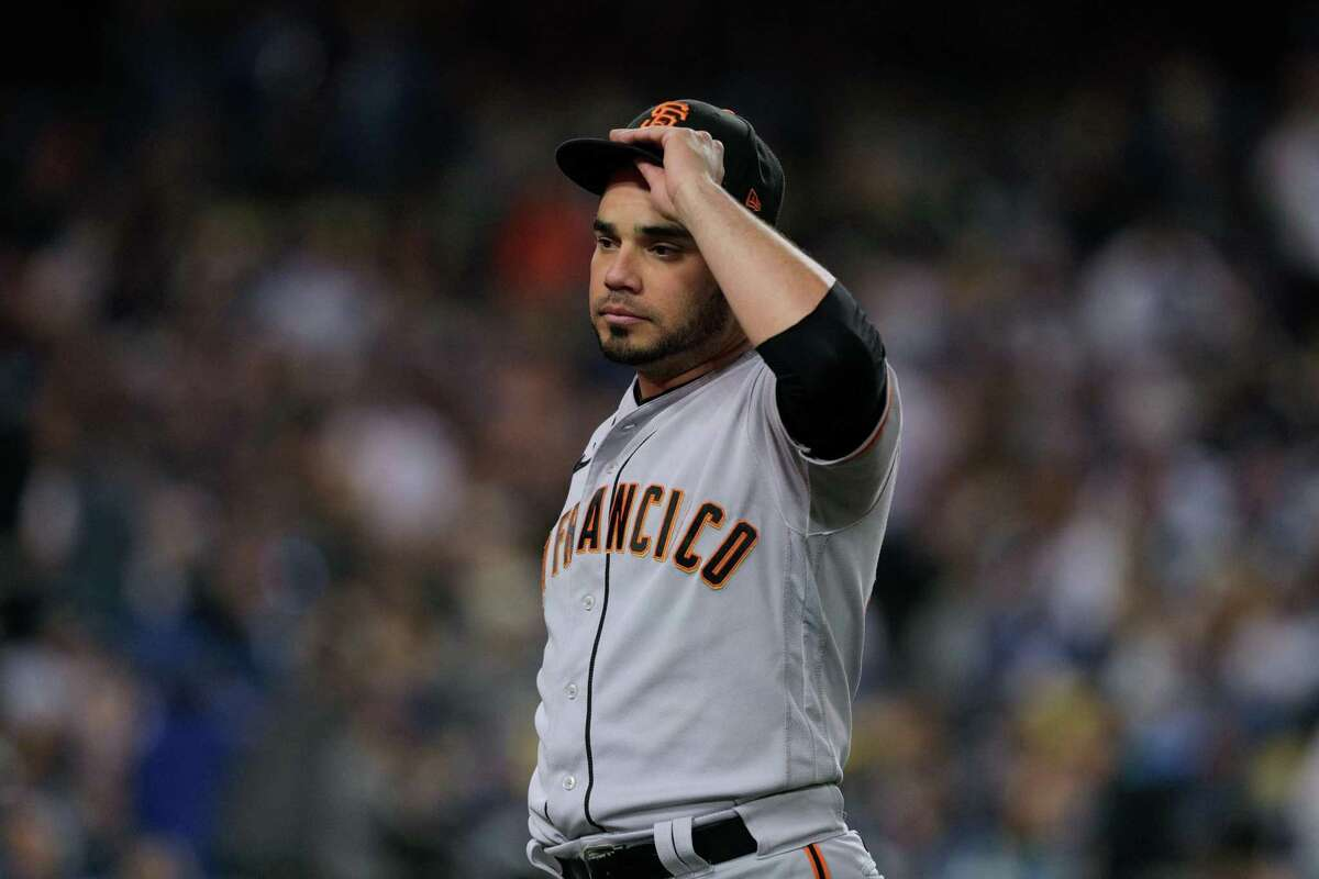 San Francisco Giants José Álvarez (48) takes a moment while pitching during the bottom of the second inning as the San Francisco Giants played the Los Angeles Dodgers in Game 4 of the National League Division Series at Dodger Stadium in Los Angeles, Calif., on Tuesday, Oct. 12, 2021.