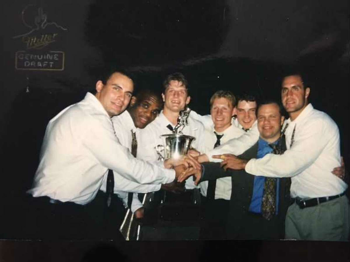 El Paso coach Todd Brost (second from right) and Buzzards players (from left) Sean Whyte, Rob Haddock, Rusty McKie, Jason Welch, Martin Balleux and Steve Salhany pose with the President's Cup after winning the first Western Professional Hockey League championship in April 1997.