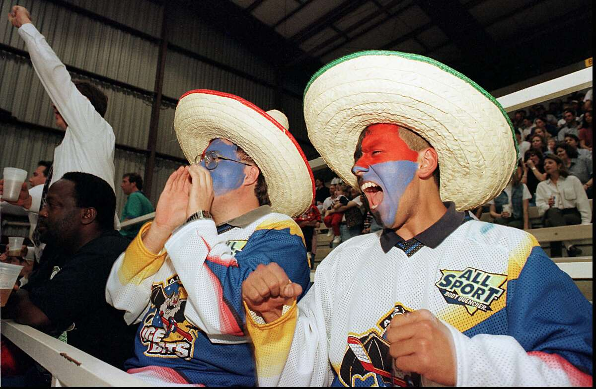 It didn't take long for fans to take to the Ice Bats in Austin during the 1996-97 WPHL season, as seen here with David Remington (left) and Joey Lopez showing their support for the hometown team with face paint and team jerseys.
