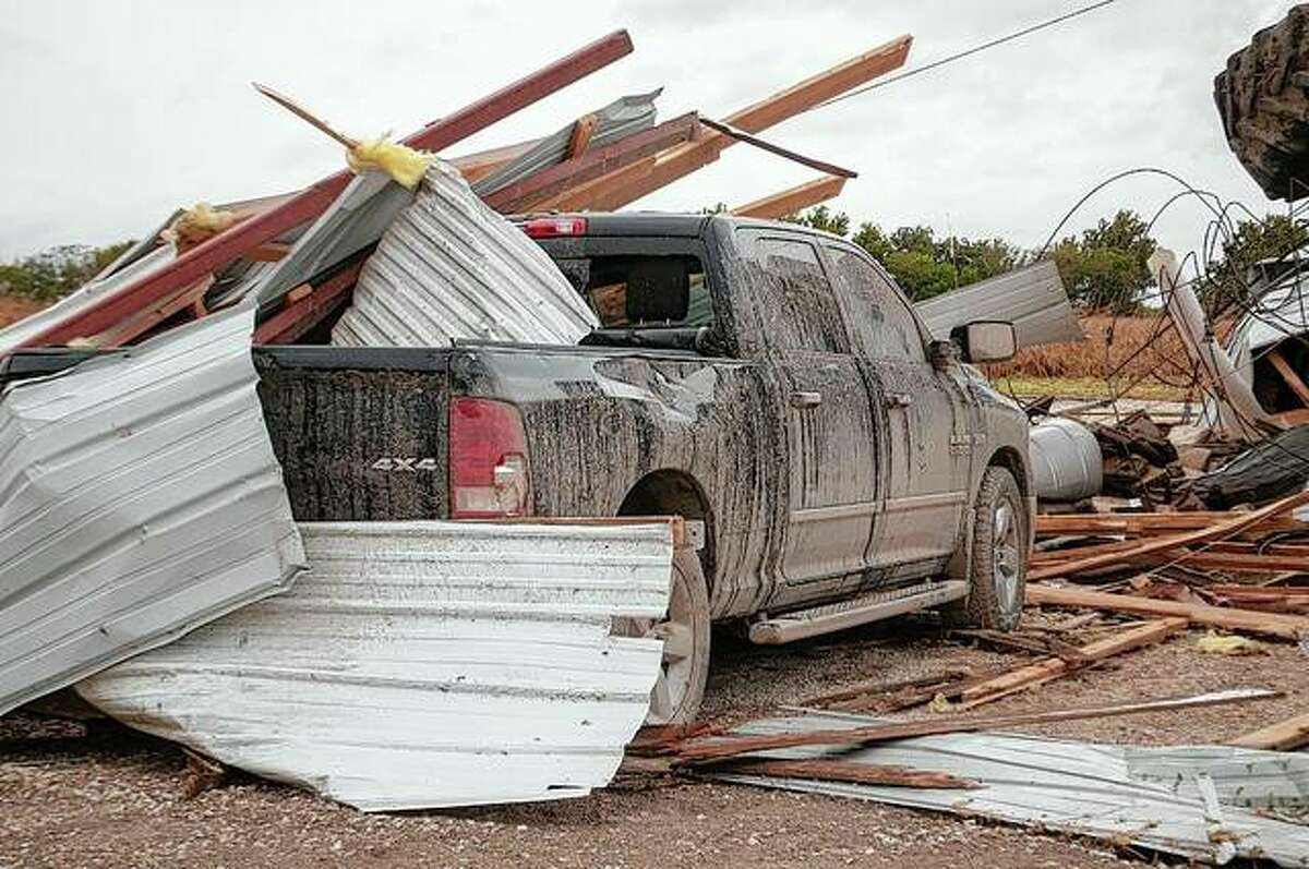 Two people were in their pickup truck Monday afternoon when a tornado touched down in Wrights, destroying farm buildings including a silo and causing damage to the vehicle.