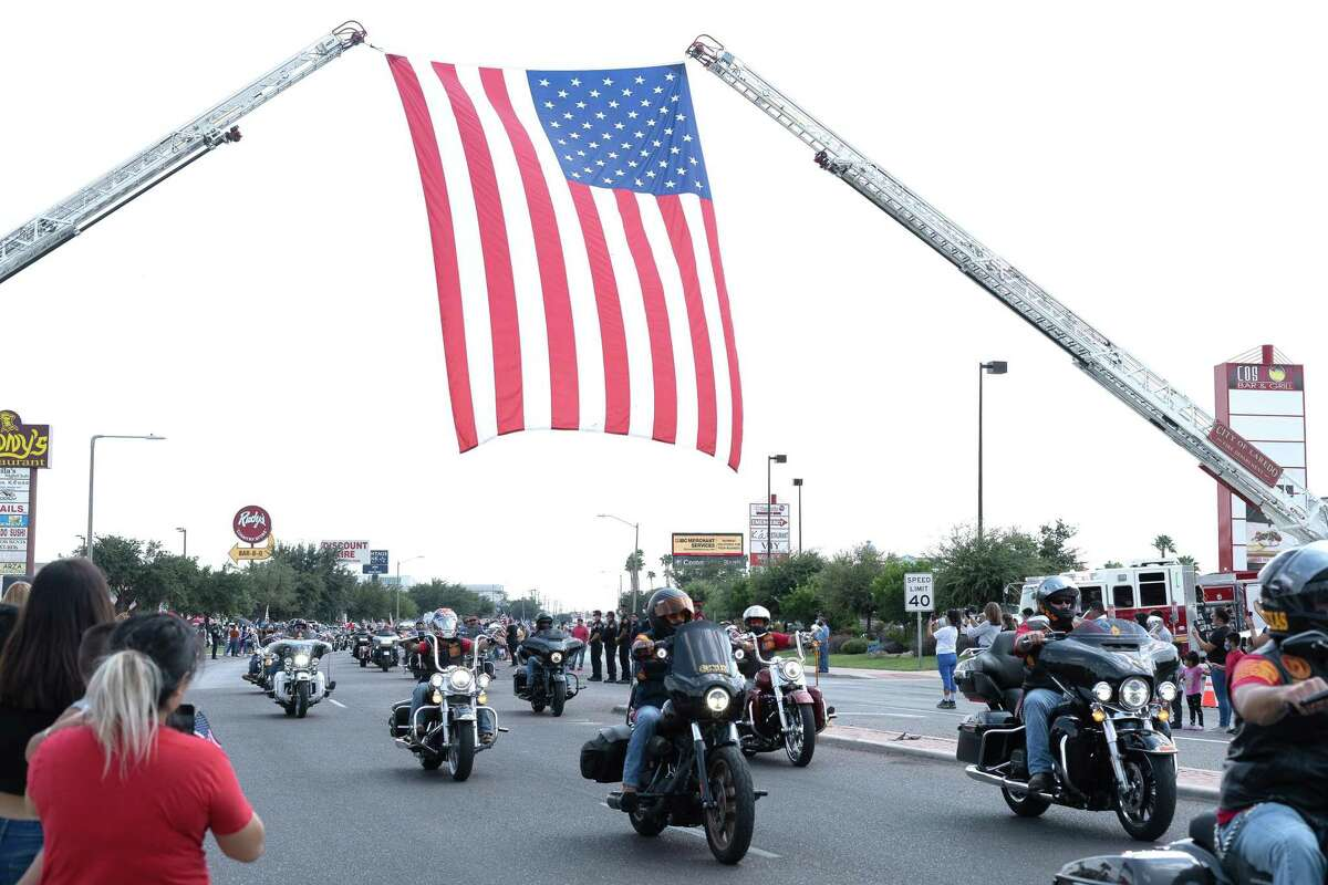 A group of bikers ride behind Marine Lance Cpl. David Lee Espinoza's funeral procession on Del Mar Boulevard on Sept. 10, 2021. At a Veterans Affairs Committee meeting Tuesday, a resolution to honor Espinoza was passed to create an agenda item for the upcoming city council meeting.