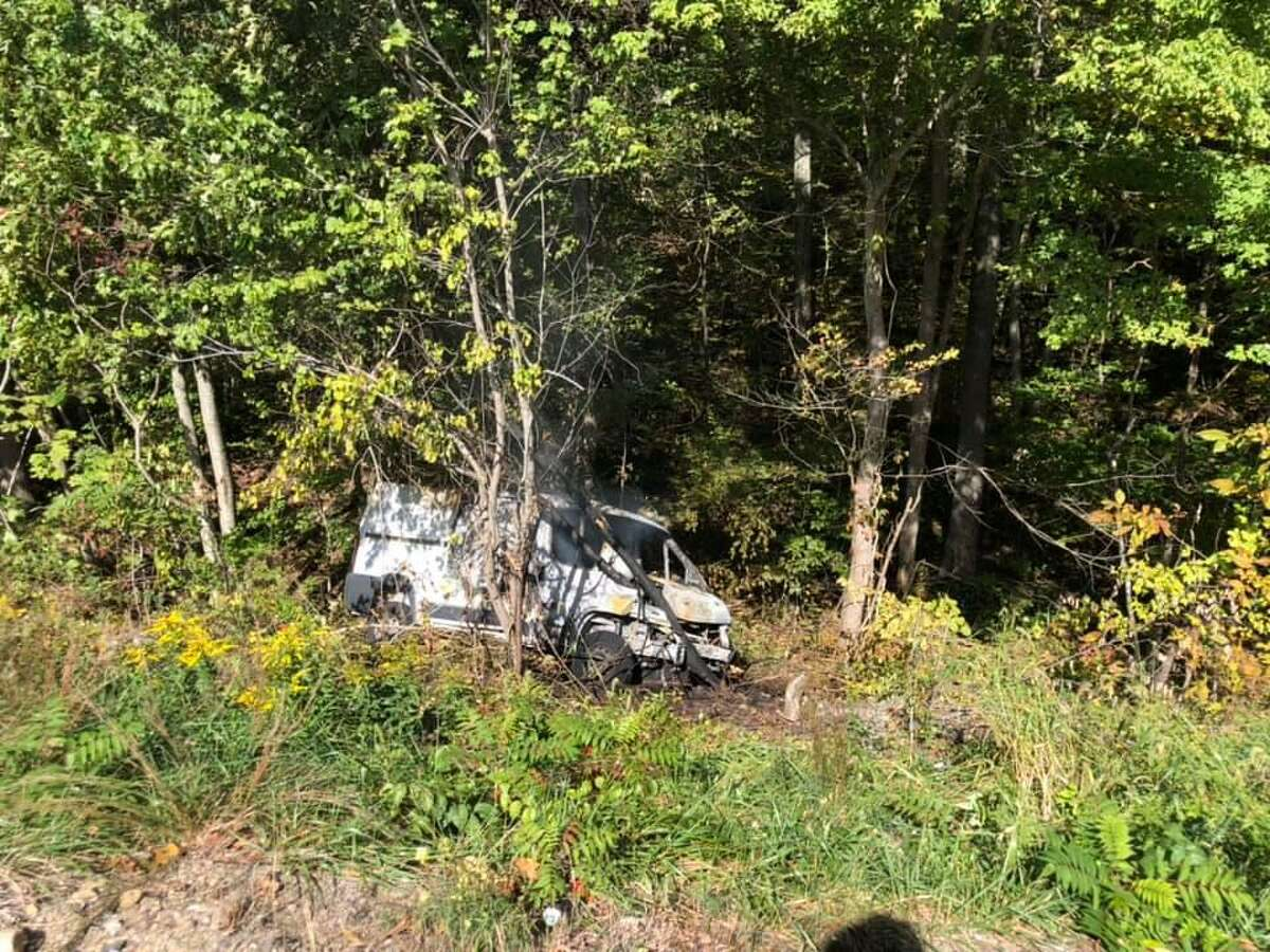Crews extinguished a vehicle fire off Interstate 95 in Groton, Conn., on Tuesday, Oct. 12, 2021.