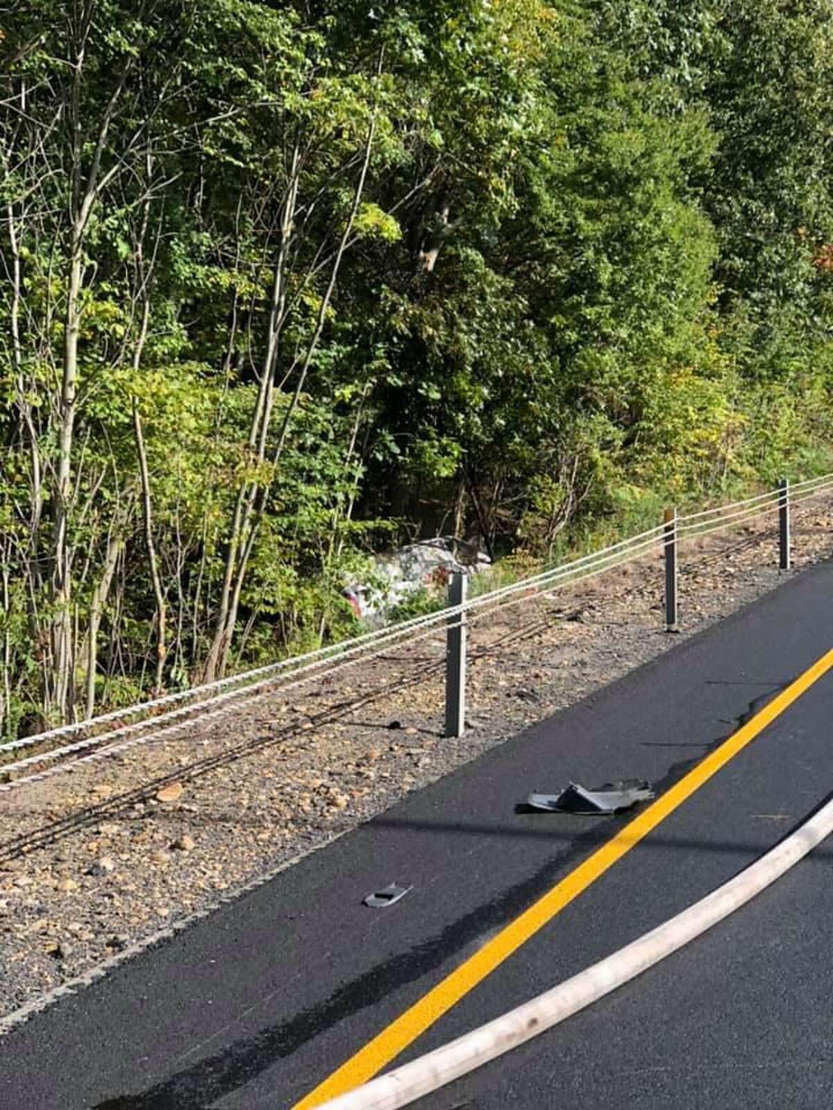 A vehicle crashed into the woods off Interstate 95 in Groton, Conn., on Tuesday, Oct. 12, 2021.