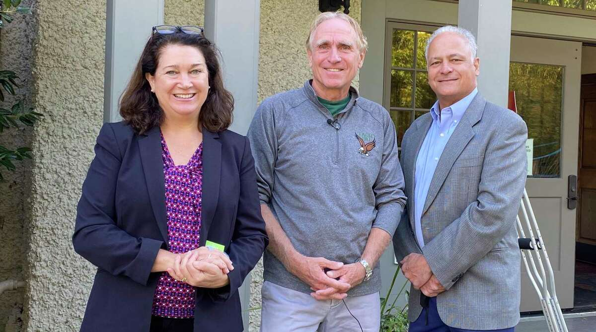 From left, Danielle Blaine of Food Rescue US, Tom Cone of Greenwich's Eagle Hill School and John Gutman of Stamford's New Covenant Center have entered into a partnership to deliver unused prepackaged school meals to clients of the Stamford nonprofit.