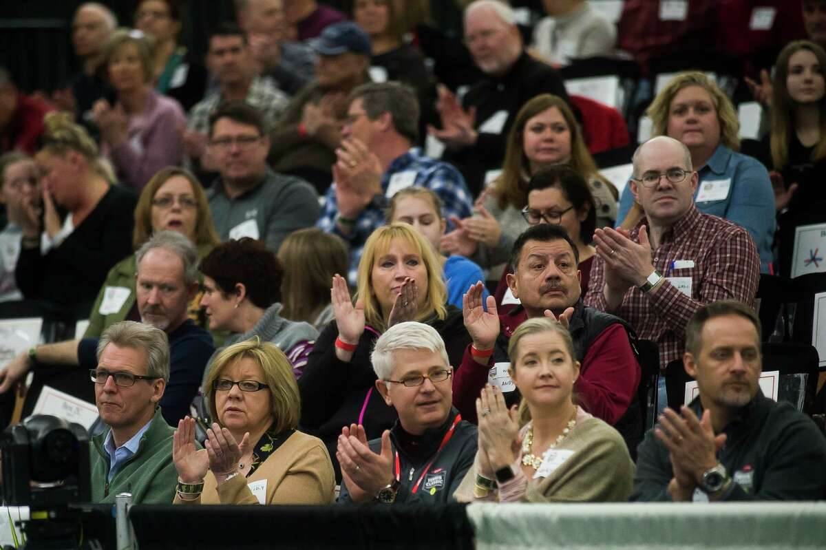 Spectators applaud during the award ceremony for the Dow Tennis Classic singles tournament Sunday, Feb. 9, 2020 at the Greater Midland Tennis Center. (Katy Kildee/kkildee@mdn.net)