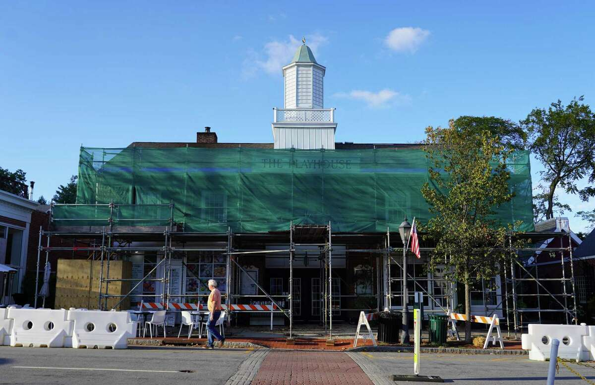 The New Canaan Playhouse is shrouded in tarps and scaffolding covers the facade on October, 12, 2021.