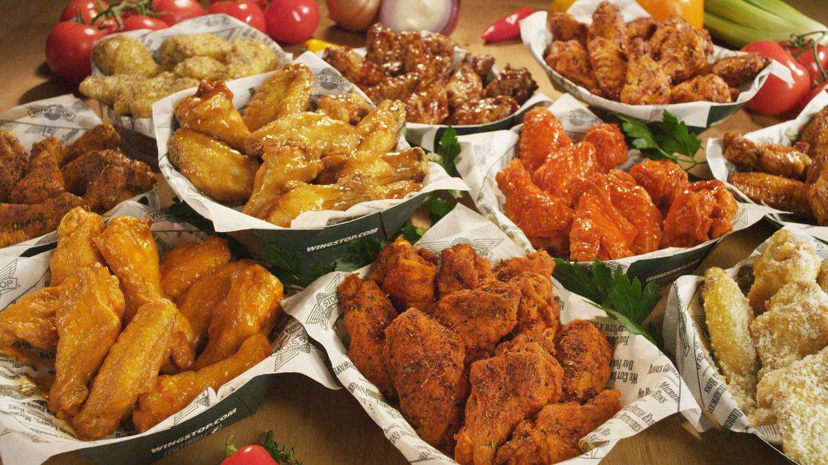 A table full of wings at Wingstop.