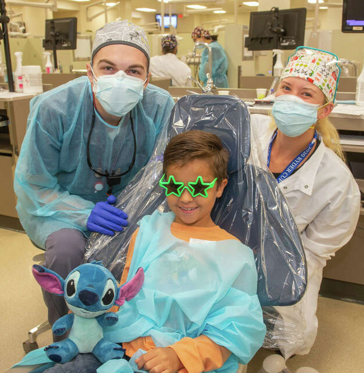 A child receives dental care during the SIU SDM's Give Kids a Smile Day event on Oct. 11. A record number of 126 children received treatments valued at more than $61,000 on Monday.