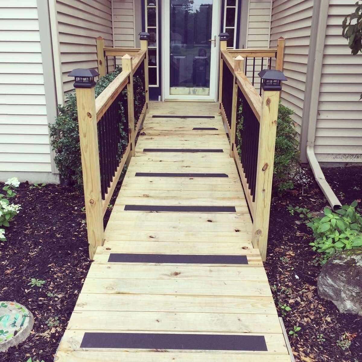 An example of a perfect ramp with lights, rubber treads to prevent slipping and correct grade so it's not too steep.