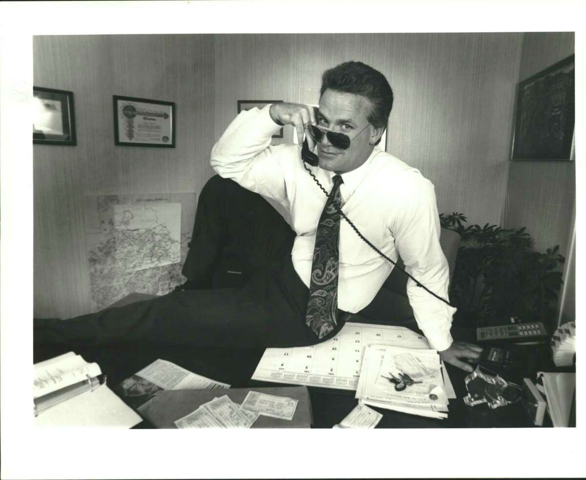 Lyle Larson poses GQ-style for a photo to illustrate an Express-News story about unusual phone calls he received from women in the early 1990s wanting to meet the good-looking guy at City Hall.