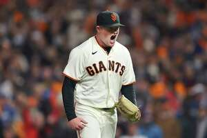 San Francisco Giants pitcher Logan Webb reacts after striking out Los Angeles Dodgers' Trea Turner during the sixth inning of Game 1 of a baseball National League Division Series Friday, Oct. 8, 2021, in San Francisco.