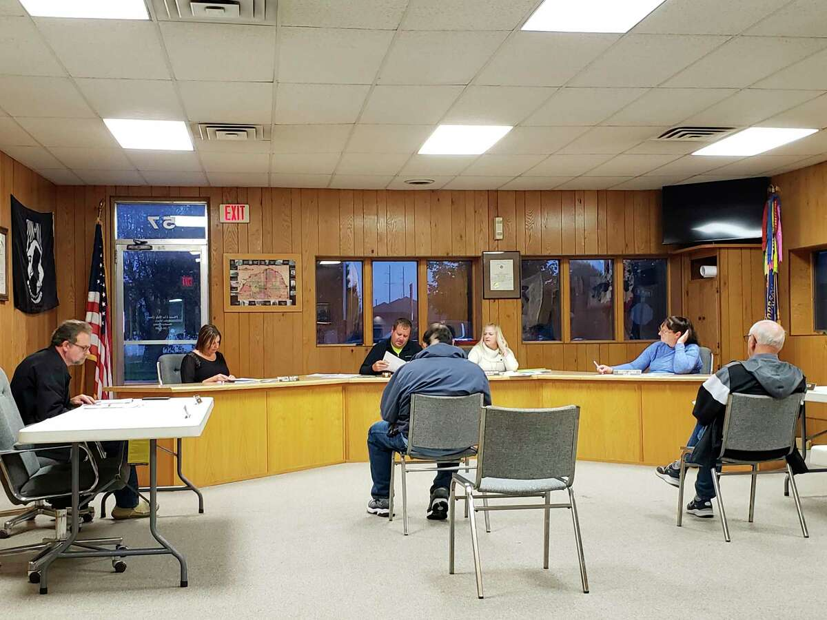 The Elkton Village Council during their monthly meeting on Tuesday, where they approved allowing medical marijuana to be grown in residences in the village. The council also approved Agri-Valley Service's plan to install fiber-optic infrastructure throughout the village in 2022. (Robert Creenan/Huron Daily Tribune)