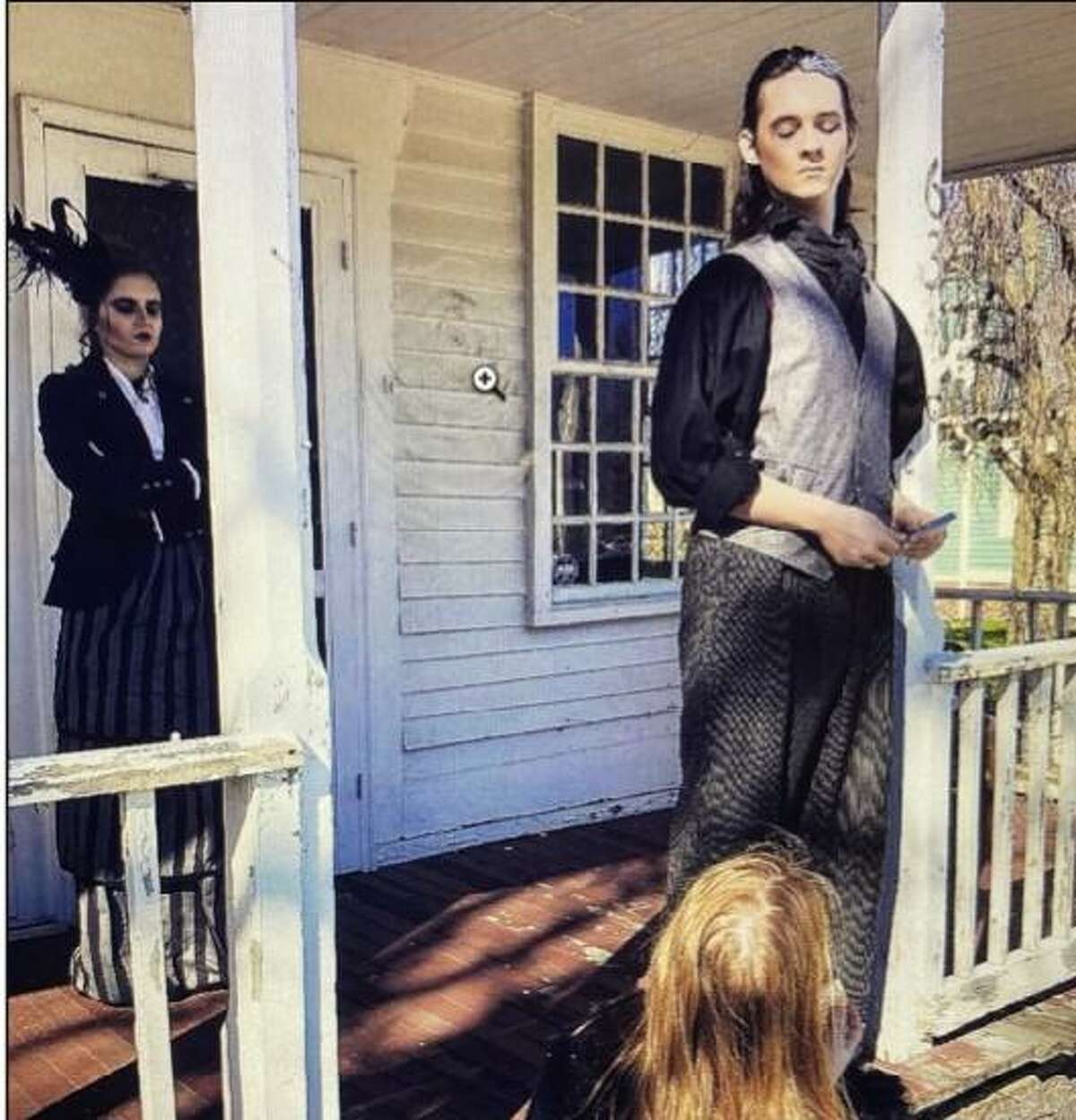Kidz Konnection actors stand on the porch of the Adam Stanton House in Clinton.