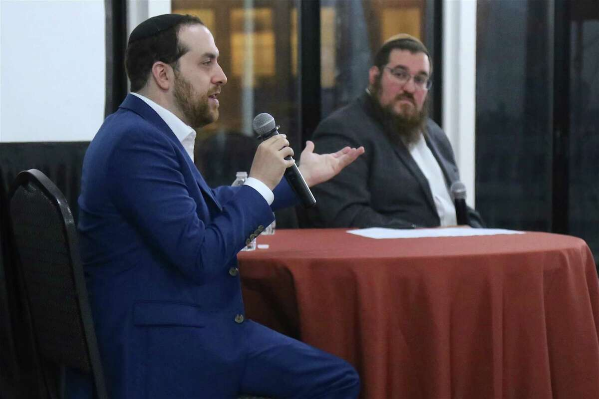 """Rabbi Shlame Landa, right, listens as writer Yair Rosenberg of New York City talks about anti-Semitism during the program, """"Today's Encounters with Anti-Semitism,"""" held on Oct. 10, 2021 at the Jacky Durell Pavilion."""