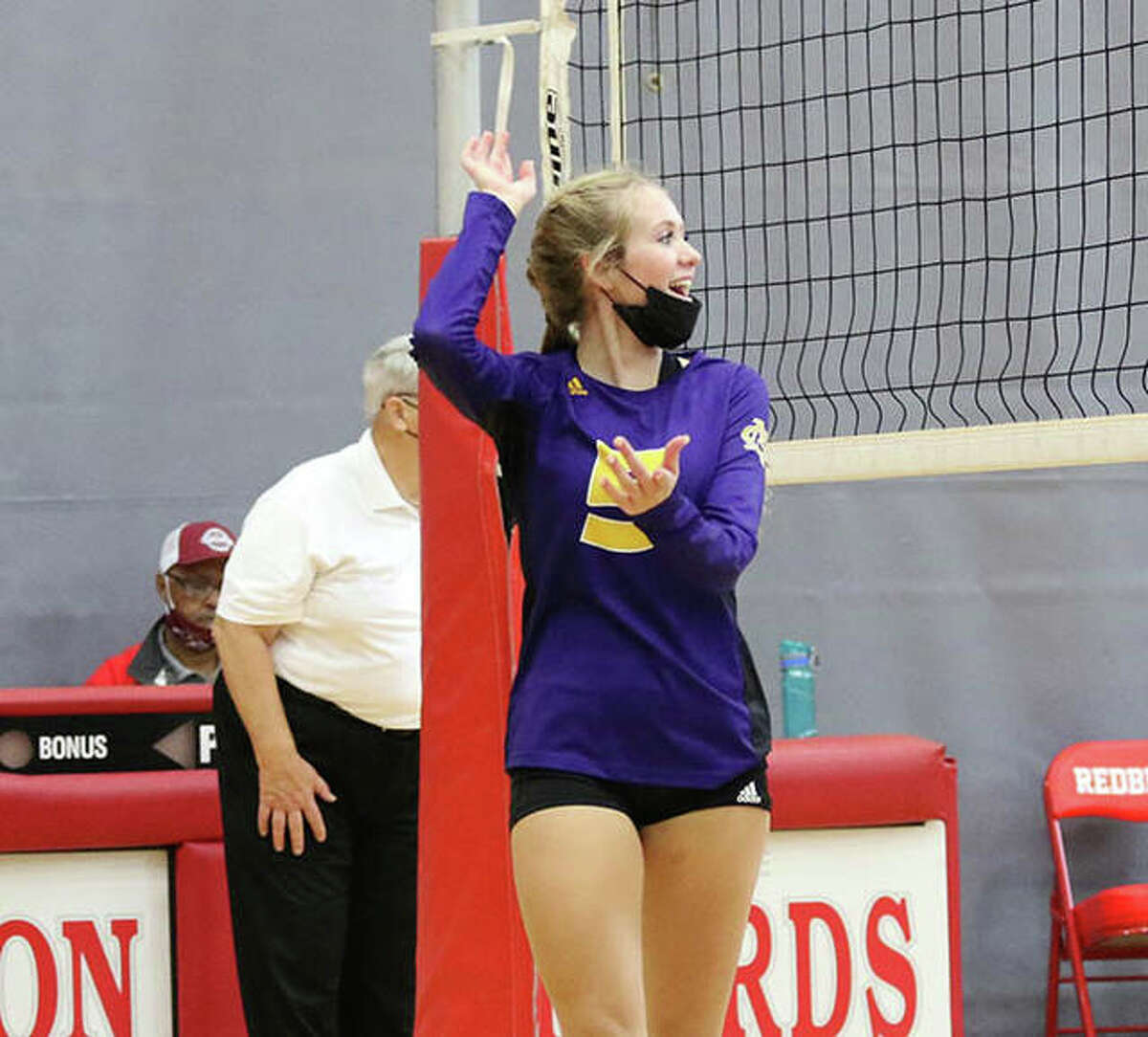 CM's Annabelle Reno, shown celebrating a kill in a match in the Alton Tourney on Sept. 11, put down a career-high 10 kills on Tuesday night in the Eagles' three-set MVC victory over the Triad Knights in Troy.