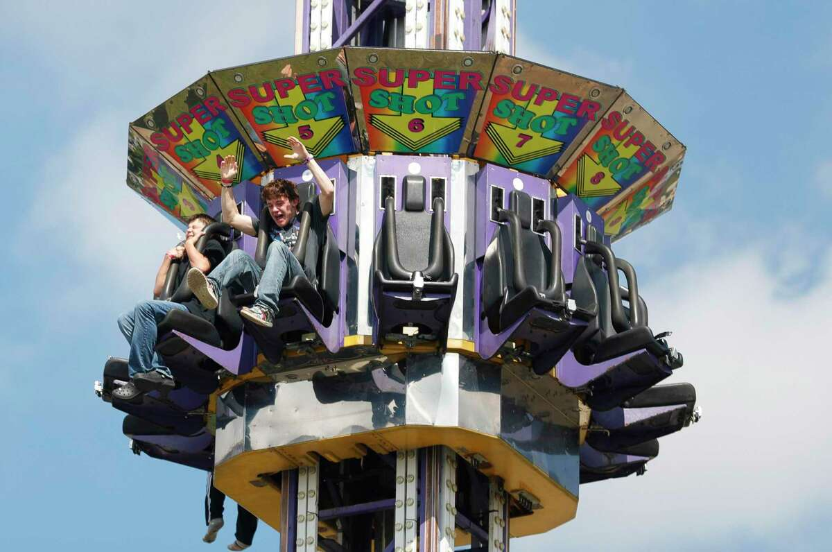 Jonathan Harcrow screams as he enjoys a carnival ride during the annual Conroe Cajun Catfish Festival, Saturday, Oct. 9, 2021, in Conroe.