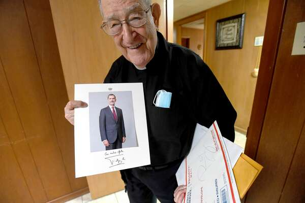 Fr. Luis Urriza shows a personally signed photo from Felipe VI - the King of Spain - which accompanied a note from the King and Queen honoring him on his 100th birthday in August. Photo made Monday, October 4, 2021 Kim Brent/The Enterprise