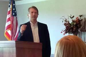 Democratic candidate for mayor Stephen Ivain spoke to members of the Torrington-Winsted Rotary Club Oct. 13. Listening is Torrington Library director Jessica Gueniat.