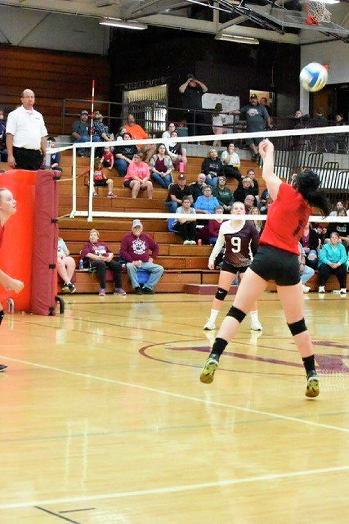 Owendale-Gagetown's Karlie Morrish bumps the ball over the net. (Carrie DeLaCruz/Courtesy Photo)