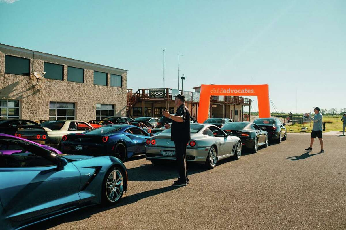 """Participants lined up to drive parade laps during """"Drive for Kids"""" event."""