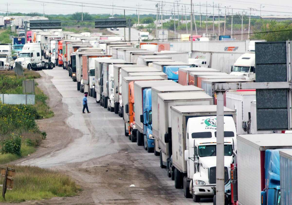 Trucks wait in line on the Mexican Federal Highway Two to cross to the United States from Nuevo Laredo on Wednesday, April 3, 2019.