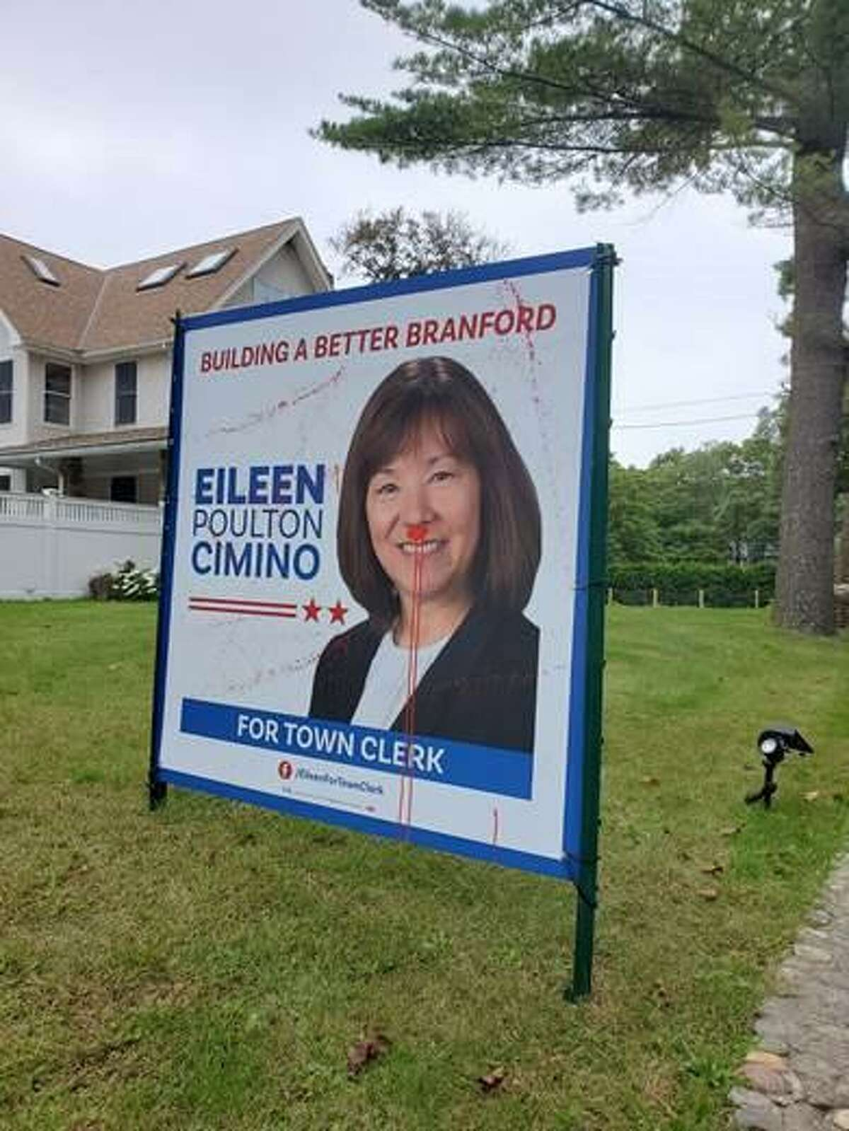 Democrats said this sign for town clerk hopeful Eileen Poulton Cimino was among signs vandalized over the weekend.