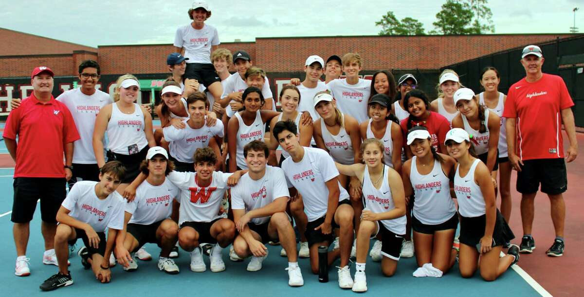 The Woodlands team tennis celebrates its bi-district win over Aldine Nimitz on Tuesday, Oct. 12, 2021