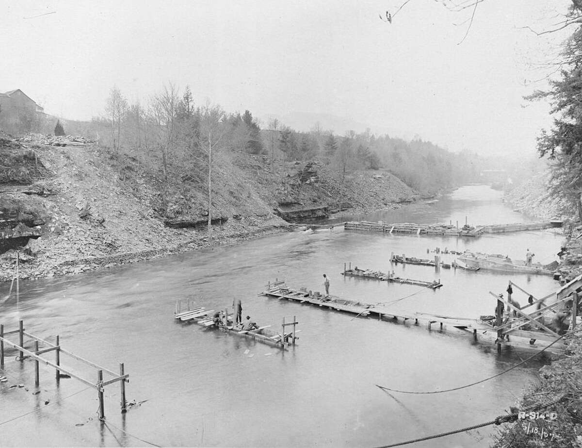 Thousands of people were relocated and hundreds of buildings moved or torn down to make way for the Ashokan Reservoir, about 10 miles west of Kingston in Ulster County. This photo, taken in 1907 at the Olive Bridge Dam, shows coffer-dam and piers under construction for supporting the 8-foot pipes to carry the flow of water in Esopus creek.