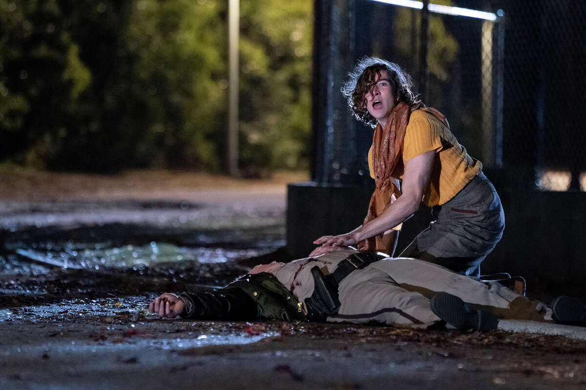 """Will Patton, left, and Dylan Arnold in """"Halloween Kills."""""""