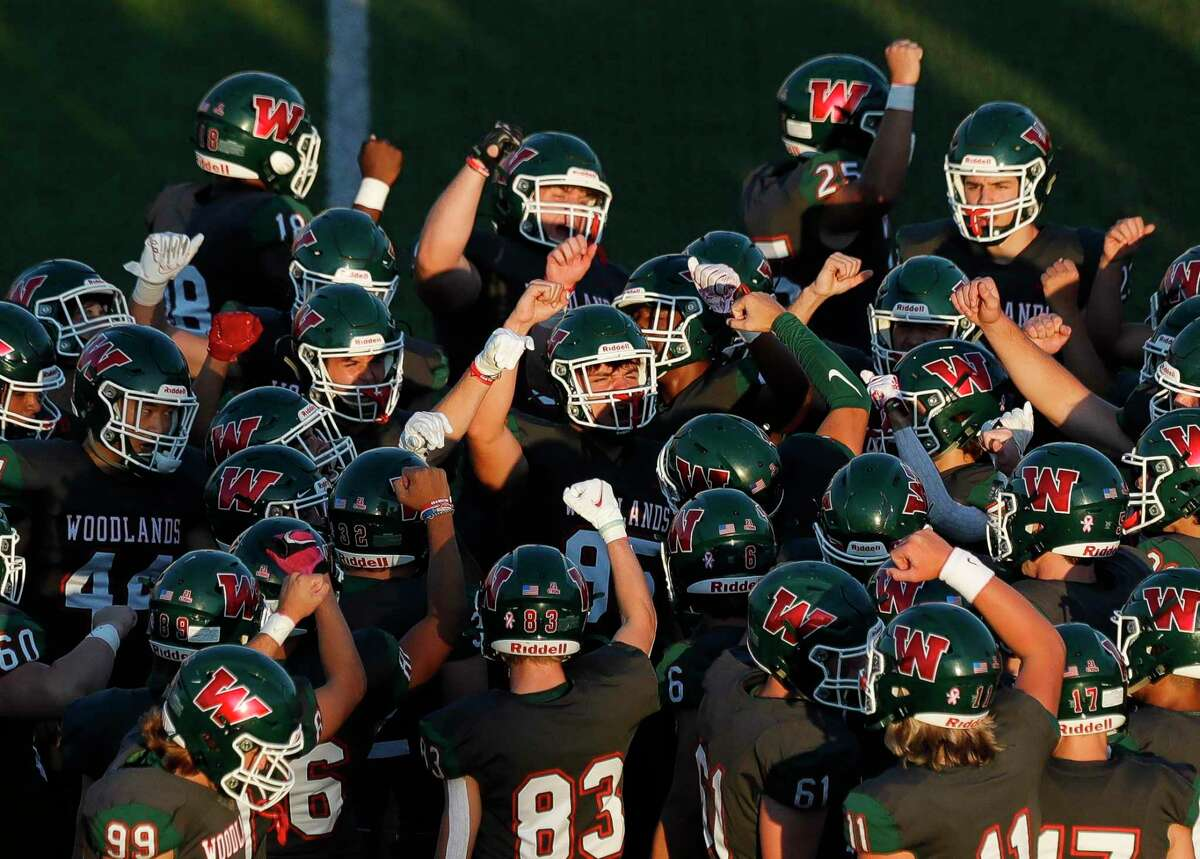 The Woodlands gather before a District 13-6A high school football game at Woodforest Bank Stadium, Thursday, Oct. 7, 2021, in Shenandoah.