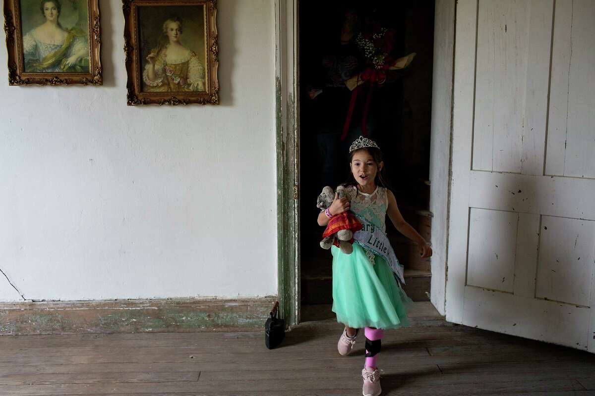 Zoe Zavala, 7, walks around the Polley Mansion after being crowned Honorary Little Miss during the 30th annual Sutherland Springs Old Town Days Royal Court Presentation Ceremony on Oct. 21, 2018, in Sutherland Springs. Zavala and her grandmother, Debbie Braden were both shot in their church and underwent extensive surgeries and rehabilitation while Debbie lost her husband and Zoe's grandfather, Keith Braden.