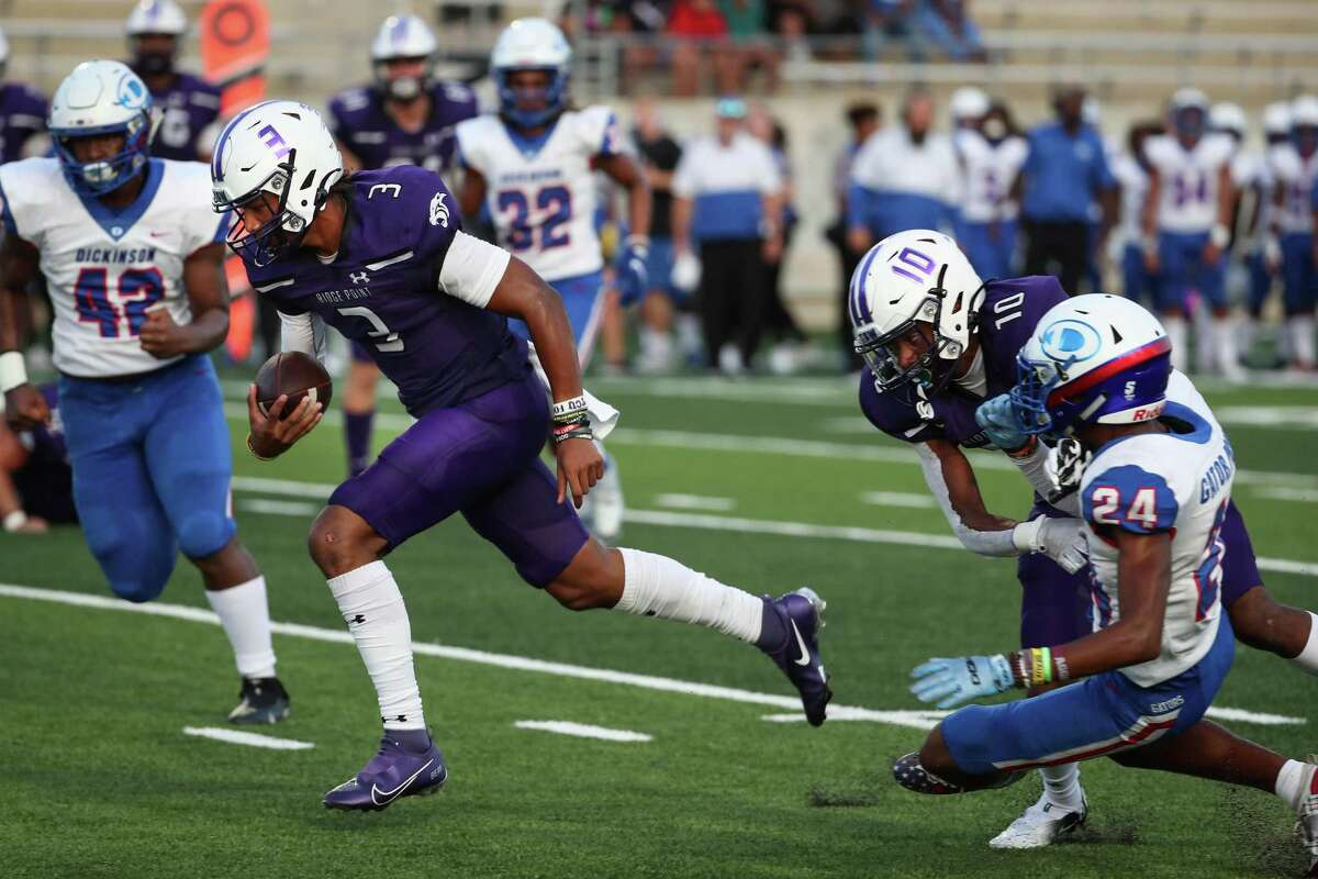 Ridge Point quarterback Bert Emanuel, Jr., (3) cuts back off a block by wide receiver Wilson Batiste (10) past Dickinson defensive back Rodney Bimage (24) for a 9-yard touchdown run during the first half of a non-district high school football game at Freedom Field Thursday, Sept. 2, 2021 in Rosharon.