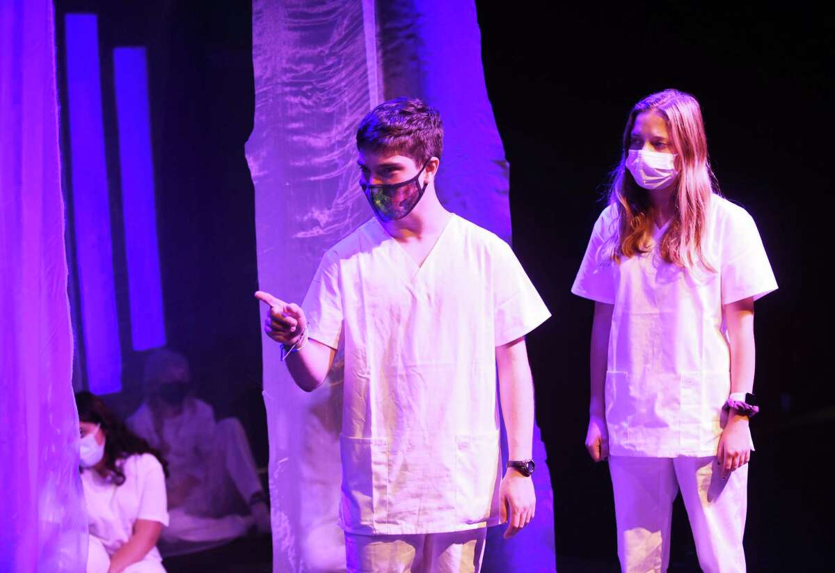 """GHS sophomore Jack Glass performs the role of Caesar alongside senior Maggie Polistina, performing as Antony, during a rehearsal of """"Julius Caesar"""" at Greenwich High School's Blackbox Theater in Greenwich, Conn. Monday, Oct. 11, 2021. GHS Theater Arts will perform the renowned Shakespeare tragedy """"Julius Caesar"""" on Oct. 15-16 and Oct. 21-23. This will be the performance in a year and a half at the school's smaller Blackbox Theater."""