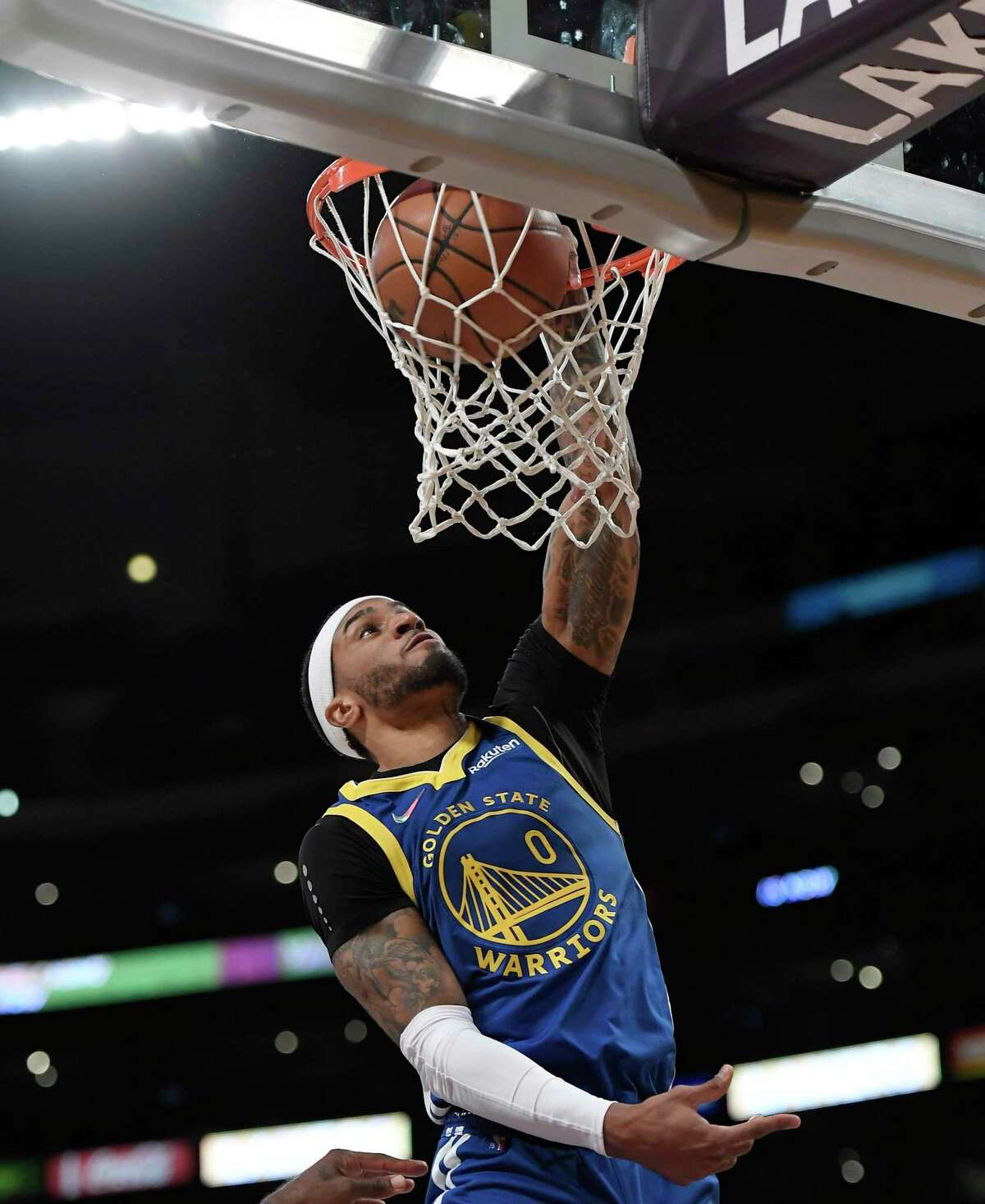 LOS ANGELES, CA - OCTOBER 12: Gary Payton II #0 of the Golden State Warriors dunks the ball against the Los Angeles Lakers during the first half of a preseason basketball game at Staples Center on October 12, 2021 in Los Angeles, California. NOTE TO USER: User expressly acknowledges and agrees that, by downloading and/or using this Photograph, user is consenting to the terms and conditions of the Getty Images License Agreement. (Photo by Kevork Djansezian/Getty Images)