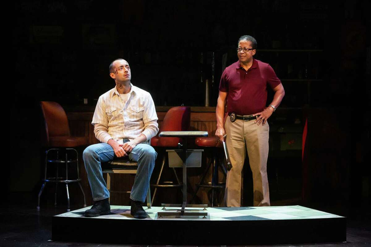 """Pasadena-area actor David Rainey, right, shown with Dylan Godwin, portrays a probation officer in the Alley Theatre's production of """"Sweat."""""""