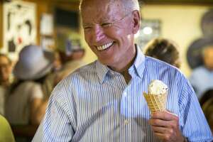 PORTSMOUTH, NH - JULY 12: U.S. presidential candidate and former Vice President Joe Biden laughs after getting served ice cream at Annabelle's Natural Ice Cream in Portsmouth, NH on July 12, 2019. (Photo by Nic Antaya for The Boston Globe via Getty Images)