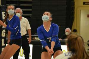 Fairfield Ludlowe's Gabby Price prepares to pass against Trumbull at Trumbull high school on Tuesday, October 13, 2020.