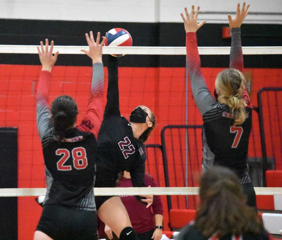 North Haven's Caroline Toni spikes the ball against Cheshire in SCC Division B girls volleyball championship game at Cheshire High School on Friday, Oct. 13, 2020.