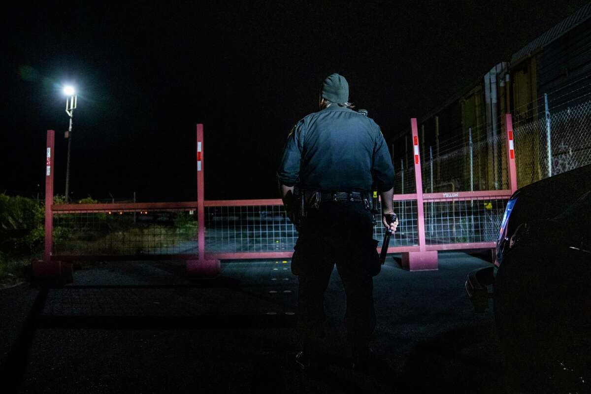 Richmond police Officer Ben Therriault of the Richmond Police Department checks out a new barrier placed at an industrial park frequented by sideshow participants.