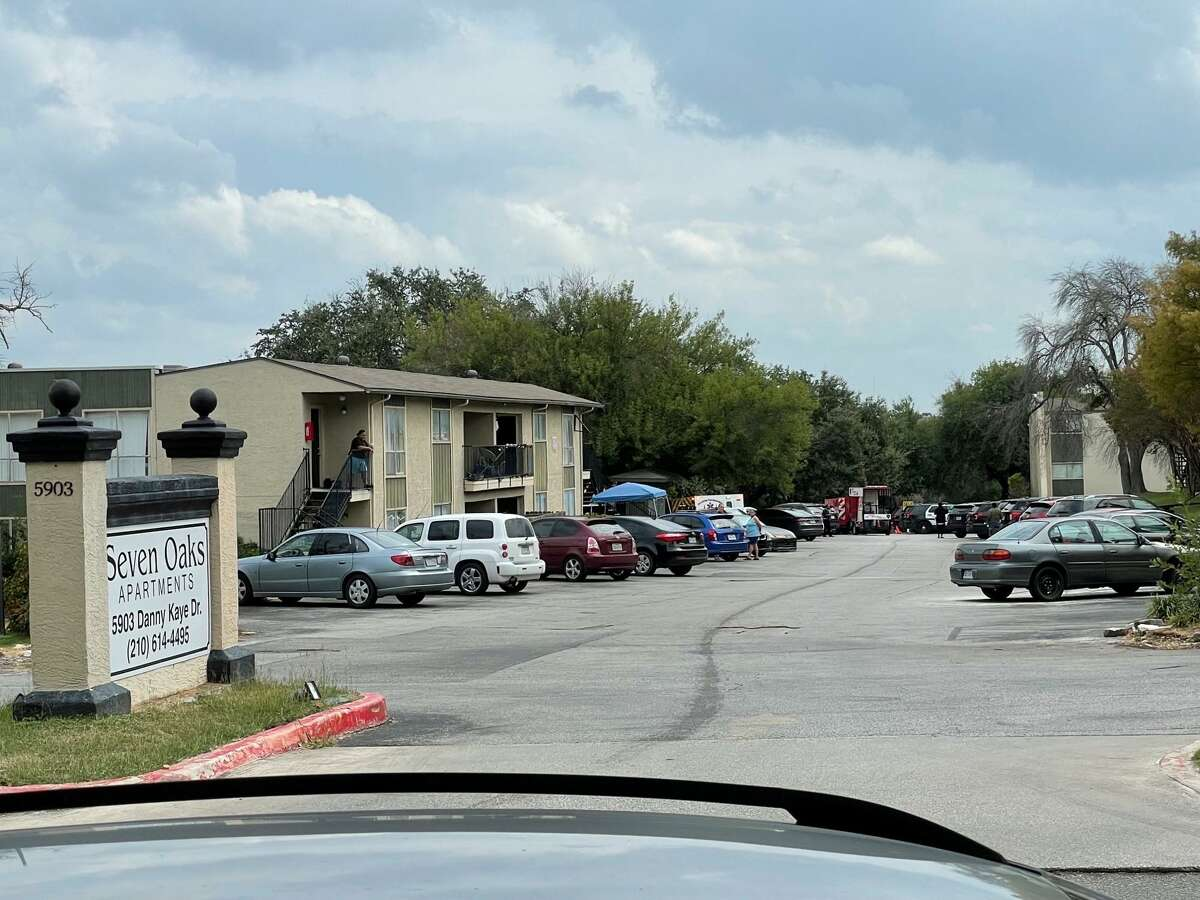 San Antonio police and firefighters respond to the scene where a man fired several shots Wednesday afternoon at the Seven Oaks apartments, 5903 Danny Kaye Drive.