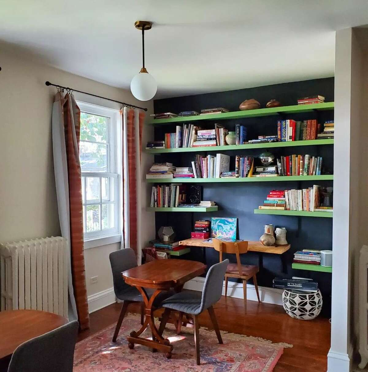 """After hitting up nearby boutiques and wine bar Brunette, guests at the Forsyth can spend downtime in the library. """"I wanted to create a beautiful and welcoming space for people to come and relax, without a lot of rules,"""" said Tamara Ehlin, who runs the B&B with her husband."""