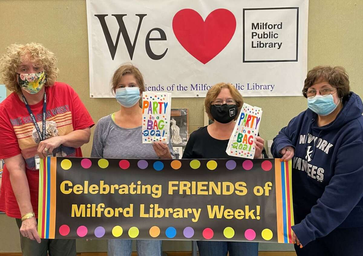 """The Friends of the Milford Library, FOML, group is participating in the sixteenth annual National Friends of the Library Week. The week is from Sunday, Oct. 17, through Saturday, Oct. 23, with a fun, free giveaway for people, who are """"friends"""" of the library. The Friends of Milford Library's annual fundraising event, """"Party in the Stacks,"""" will not be held again in 2021, due to public health concerns amid the coronavirus pandemic. As the alternative, and for the second year, the non-profit organization, will offer a """"Party in a Bag."""" People are previously shown with the """"Party in a Bag,"""" bags."""