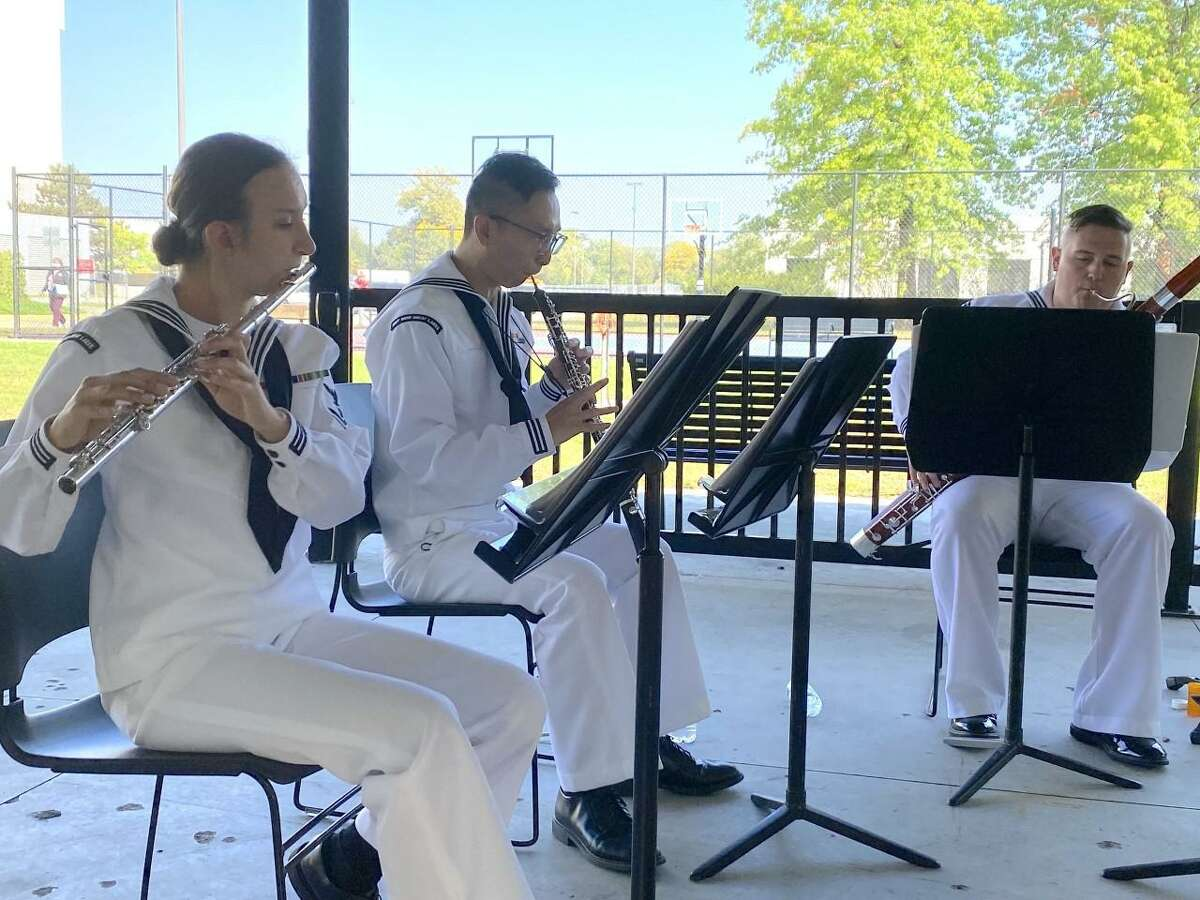 U.S. Navy Musician 3rd Class Rachael Dobosz, who is from Shelton, Conn., and who is assigned to Navy Band Great Lakes from the Navy Office of Community Outreach, NAVCO, recently plays the flute instrument, while performing at the Minneapolis Veterans Affairs Hospital during the recent Minneapolis Navy Week. The week was Sept. 26, through Oct. 2. Dobosz, left, is shown with other musicians at the Minneapolis Veterans Hospital during the Navy Week.